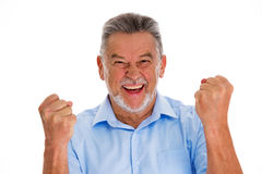 Senior man clenching fists. Senior man standing over white background Royalty Free Stock Photography