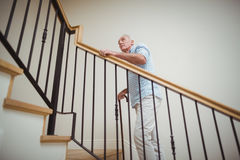 Free Senior Man Climbing Upstairs With Walking Stick Royalty Free Stock Photos - 95502868
