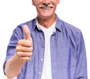 Senior man. Close-up of smiling senior man is showing thumb up royalty free stock photos