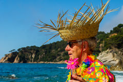 Senior man with cocktail drink at the beach Stock Photography