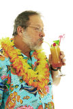 Senior man with cocktails. Smiling senior man with hawaiian shirt and flowers collar drinking exotic cocktails on white background royalty free stock photo