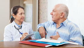 Senior man complaining to doctor Stock Photography