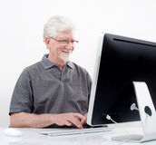 Senior man with  computer. At home Stock Image