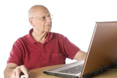 Senior man with computer. Senior man doing research on-line Royalty Free Stock Photos