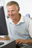Senior man on a computer Royalty Free Stock Photography