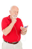 Senior Man Confused by MP3 Player royalty free stock photo