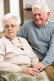 Senior Man Consoling Wife. At Home stock images