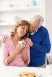 Senior Man Consoling Wife Stock Photos