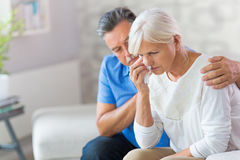 Senior Man Consoling Wife. Senior Man Consoling His Wife Stock Images
