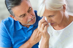 Senior Man Consoling Wife Stock Image