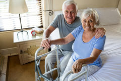 Senior man consoling woman in bedroom Royalty Free Stock Photo