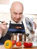 Senior man cooking Royalty Free Stock Photo