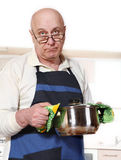Senior man cooking Stock Photos