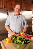Senior man cooking Royalty Free Stock Photo