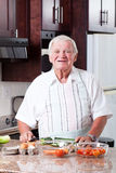 Senior man cooking Stock Photo