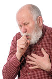 Senior man coughing, isolated on white. Handsome bald and bearded senior man coughing, isolated on white background Royalty Free Stock Photo