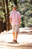 Senior man on country walk Stock Images