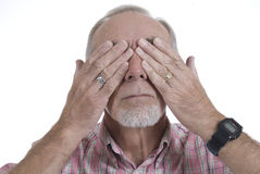 Senior man covering his eyes. Senior man refusing to see Royalty Free Stock Image