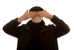 Senior man covering his eyes Royalty Free Stock Photos