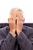 Senior man covering his face with both hands Royalty Free Stock Photo