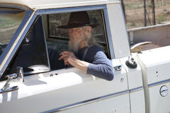 Senior Man With Cowboy Hat Sitting in Vehicle Royalty Free Stock Photography