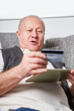 Senior man with credit card. For online banking or shopping Stock Images