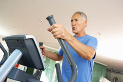 Senior Man On Cross Trainer Royalty Free Stock Images
