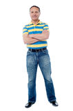 Senior man with crossed arms. Happy mature man standing with hands crossed Royalty Free Stock Photos