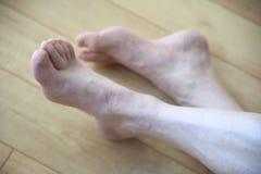 Senior man crosses legs on floor Royalty Free Stock Photos