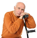 Senior man with crutch Stock Image