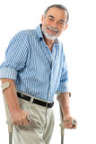 Senior man on crutches. Smiling Royalty Free Stock Image