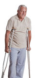 Senior Man with Crutches Stock Images