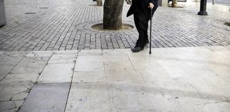 Senior man with crutches. Walking on street, health and disability old disabled white leg person cane male adult caucasian closeup human mature care help stock image