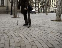 Senior man with crutches. Walking on street, health and disability old disabled white leg person cane male adult caucasian closeup human mature care help stock photos
