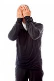 Senior man crying in grief. Senior man in his 60's shot in studio isolated on a white background royalty free stock image