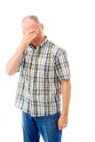 Senior man crying in grief. Senior man in his 60's shot in studio isolated on a white background stock photo