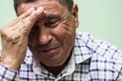 Senior man crying. Looking down, depresive royalty free stock photo