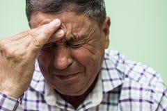 Senior man crying. Looking down, depresive royalty free stock images