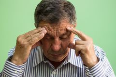 Senior man crying. Sitting in the living room royalty free stock photos