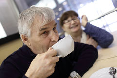 Senior man with cup of coffee Stock Image
