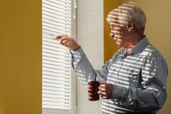 Senior man with cup Stock Photography