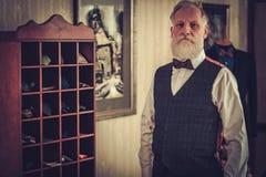 Senior man and custom made bow ties and neckties. Custom made bow ties and neckties royalty free stock photos