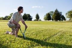 Senior Man Cutting Grass With Shears Royalty Free Stock Photos