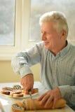 Senior Man Cutting Pie Royalty Free Stock Images
