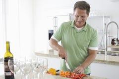 Senior Man Cutting Vegetables Stock Image