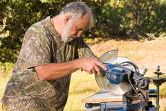 Senior Man Cutting Wood Royalty Free Stock Photo