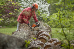 Senior man cutting wood Royalty Free Stock Photos