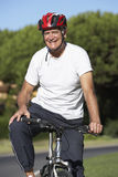 Senior Man On Cycle Ride Royalty Free Stock Photography