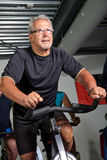 Senior man cycling Stock Photography