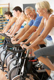 Senior Man Cycling In Spinning Class